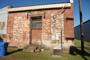 Primary view of object titled '[Rear View of Brick Building]'.