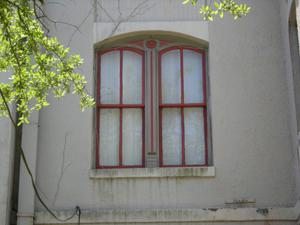 Primary view of object titled '[Close-Up of Courthouse Windows]'.