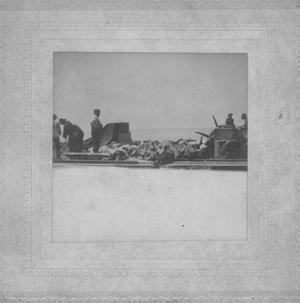 Primary view of object titled '[Aftermath of 1900 Galveston storm, storm victims' bodies on a barge]'.