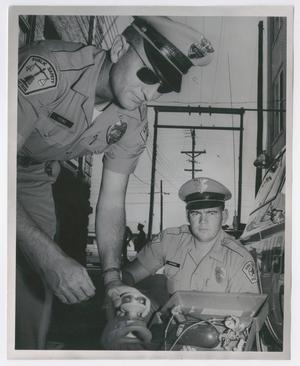 [Abilene Police Officers Ray R. Young and William J. McKenzie]