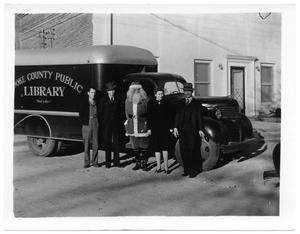 Primary view of object titled '[Bookmobile and Santa Claus]'.