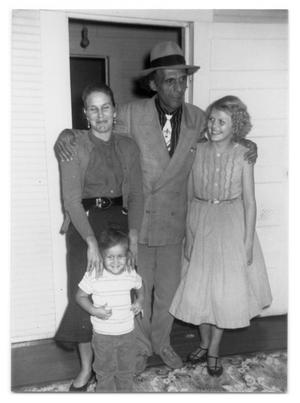 [Bill, Bill's wife, child and Marie Edwards]