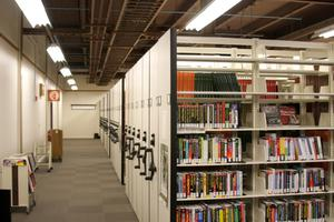 Primary view of object titled '[Compact Bookshelves at Research Park Library]'.