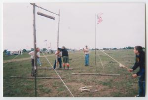 Primary view of object titled '[Boy Scouts Building a Camp Entrance]'.