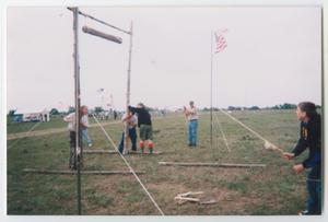 [Boy Scouts Building a Camp Entrance]