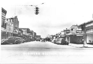 Primary view of object titled '[Business section of Rosenberg taken from Avenue H]'.