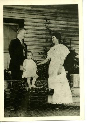 Primary view of [Sam and Nettie Fuller With Son Samuel Hyde Fuller on Front Porch]