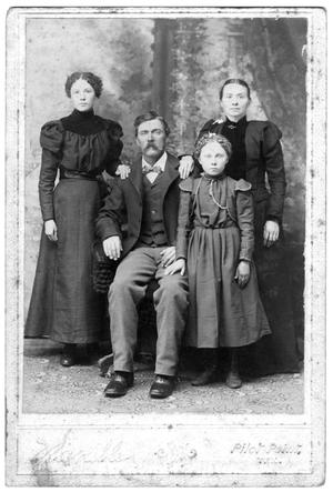 Primary view of object titled 'A couple with two girls'.