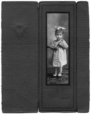 Primary view of object titled '[Young girl in white lacy dress with doll]'.