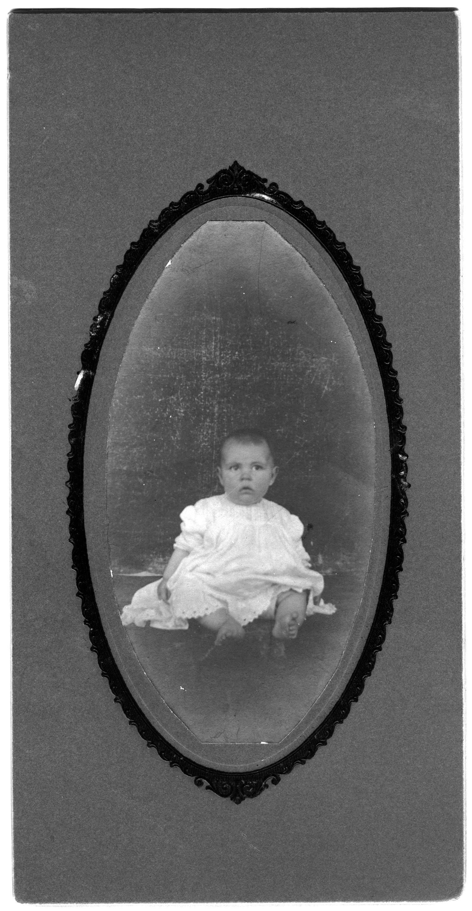 [Portrait of unidentified baby in white dress]                                                                                                      [Sequence #]: 1 of 1