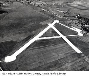 Primary view of object titled 'Municipal Airport after completion of Runways, a W.P.A. Project'.