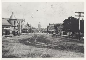 Primary view of object titled '[Congress Avenue and the Capitol Building]'.