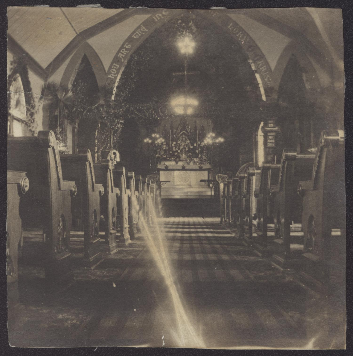 [Interior of St. Davids Episcopal Church], Photograph of the sanctuary of St. Davids Episcopal Church. It is decorated with lights and garland for Christmas.,