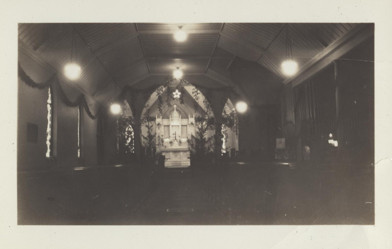 [Interior of St. Davids Episcopal Church], Photograph of the sanctuary of St. Davids Episcopal Church decorated with lights and garland.,