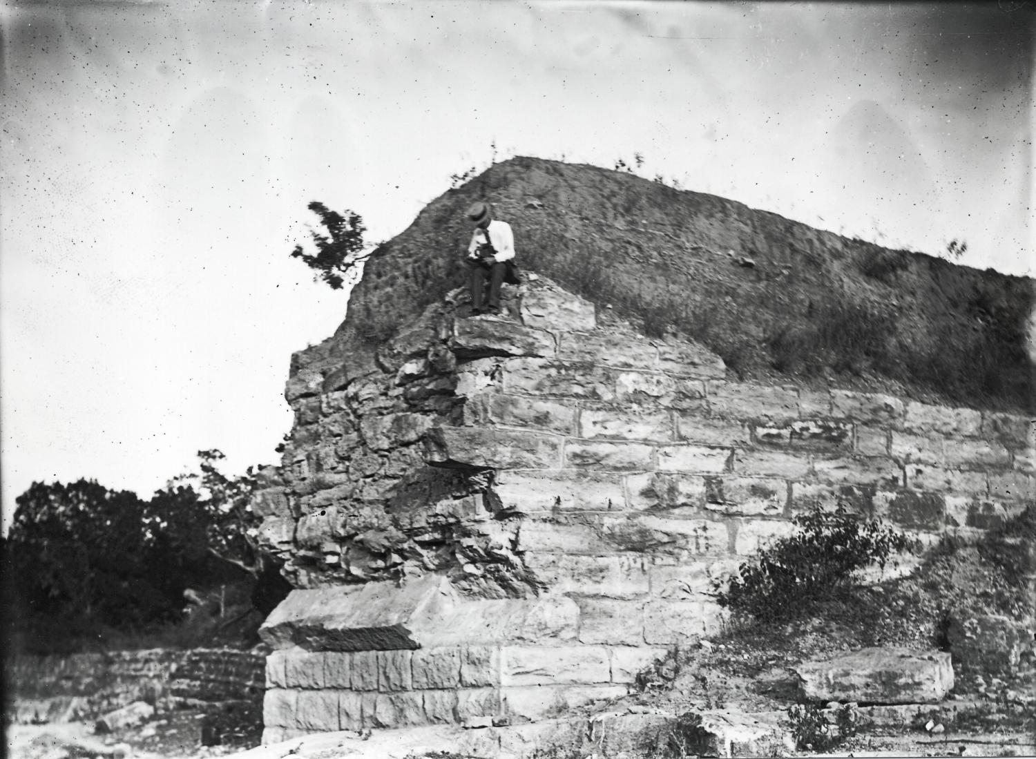 [Man Sitting on Ledge at Barton Creek]                                                                                                      [Sequence #]: 1 of 1
