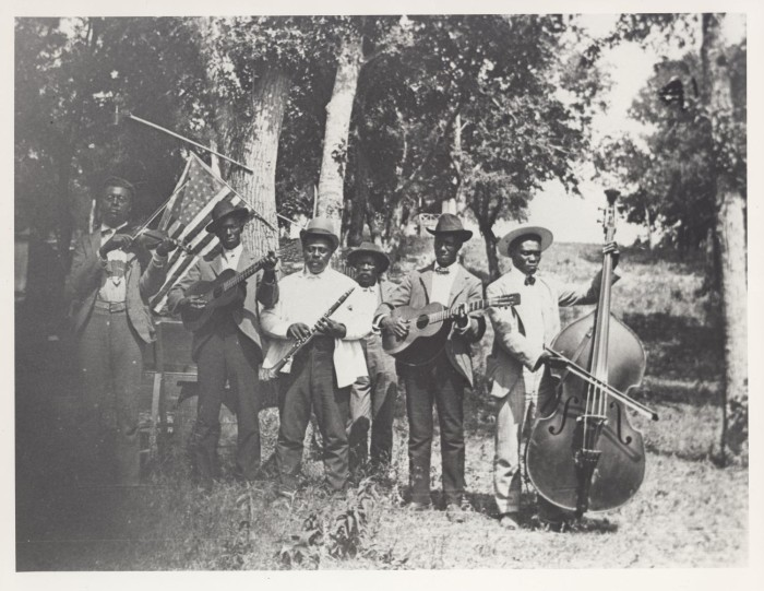 First side of: [Emancipation Day Celebration band, June 19, 1900], a photograph available in the The Portal to Texas History