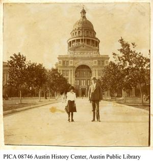 [Father and Daughter pose in front of Texas State Capitol]