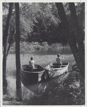 Primary view of object titled '[Two boys fishing from rowboats]'.