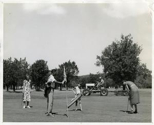 Primary view of [Golfers and caddy on green at Austin Municipal Golf Course]
