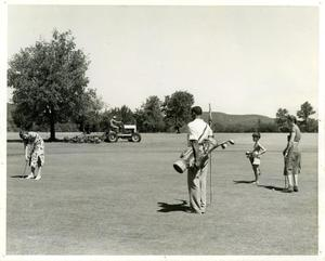 Primary view of object titled '[Golfers putting on green at Austin Municipal Golf Course]'.