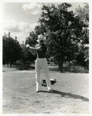 Primary view of object titled '[Golfer teeing off at Municipal Golf Course]'.