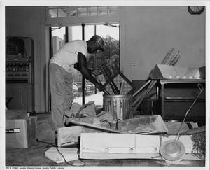 Primary view of object titled '[Frank Albrecht cleaning out Austin Athletic Club]'.