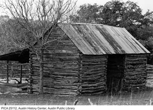 Primary view of object titled '[Exterior of log cabin at Bohl's Place]'.