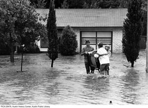 Primary view of object titled '[Men Saving Belongings from Flood Waters]'.