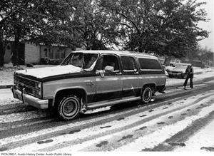 Primary view of object titled '[Station wagon pulls Jackie Gerber, skiing on snow]'.