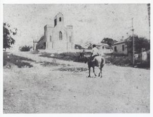 Primary view of object titled '[Man on Horse by St. David's Episcopal Church]'.