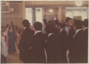 Primary view of object titled '[Groomsmen wait to catch the garter at a wedding at the San Jose Community Center in Montopolis]'.