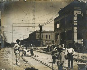 Primary view of object titled 'Brick laying crew, West Sixth Street, looking West'.