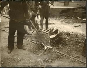 Primary view of object titled '[Smelting crew joining rail ties]'.