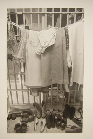 Primary view of object titled '[Female clothing hanging on a rope line in a Travis County Jail cell]'.