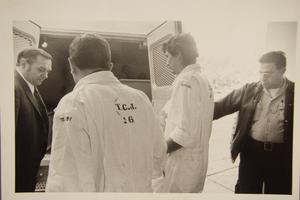 Primary view of object titled '[Guards transporting inmates by van]'.