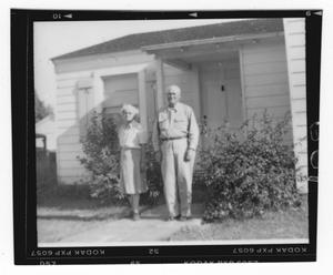 Primary view of object titled '[John and Jennie Blankenship in Front of a House]'.