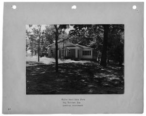 Primary view of object titled '[Photograph of Big Thicket Inn at White Rock Lake Park]'.