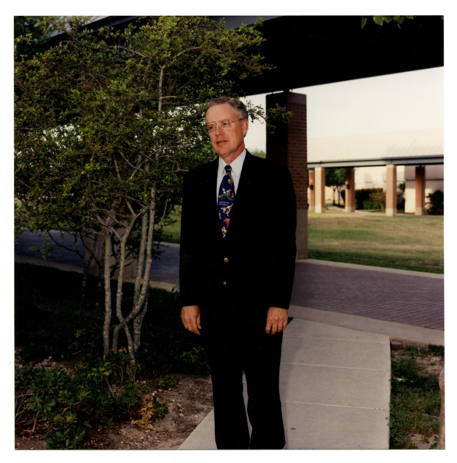 [Photograph of Dr. Kenneth M. Shumate]                                                                                                      [Sequence #]: 1 of 2