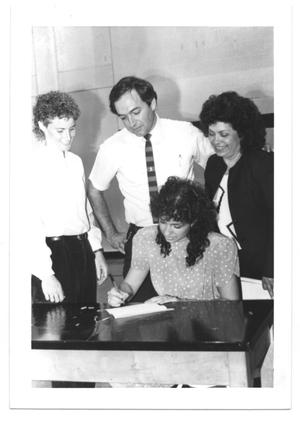 Primary view of object titled '[Photograph of Emily Staats with Student and Parents]'.