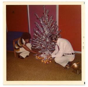 Primary view of object titled '[Staff Members Decorating for Christmas]'.