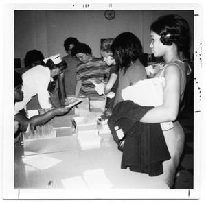 Primary view of object titled 'Nurse Oligar checking student immunization records'.