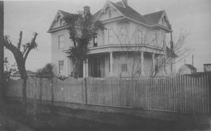 Primary view of object titled '[Postcard image of a two and a half story Richmond home]'.