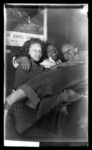 Primary view of object titled '[Three People Seated Together]'.