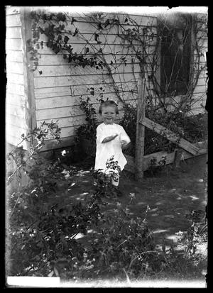 Primary view of object titled '[Young Infant in Yard]'.