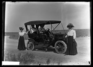 Primary view of object titled '[People with Car]'.