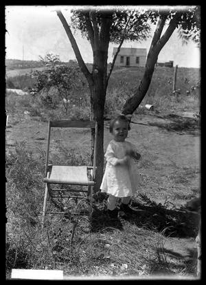 Primary view of object titled '[Infant by Folding Chair]'.