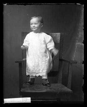 Primary view of object titled '[Baby Standing on Chair]'.