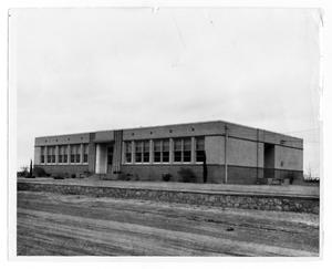 Primary view of object titled '[Dirt Road in Front of Building]'.