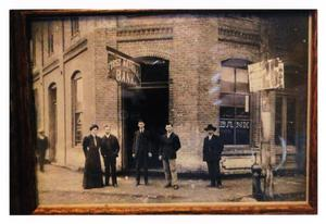 Primary view of object titled '[Group in Front of First National Bank]'.