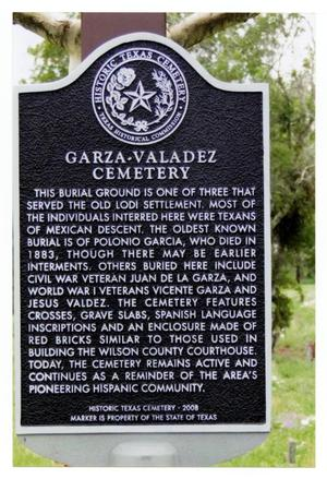 Primary view of object titled '[Plaque at Garza-Valadez Cemetery]'.